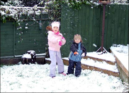 Georgia and Marcus Dickinson throwing snowballs