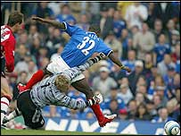 Saints keeper Antti Niemi brings down Portsmouth striker Lomana Tresor LuaLua to concede the penalty which led to the home side's first at Fratton Park