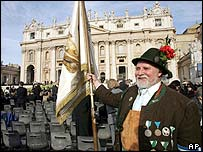 A man in traditional Bavarian dress in St Peter's Square