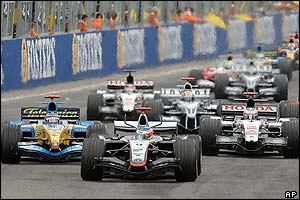 McLaren-Mercedes driver Kimi Raikkonen leads the pack at the start of the San Marino Grand Prix