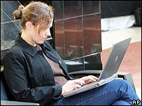 Woman using a laptop in the US