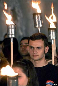 Armenians holding torches at a memorial service