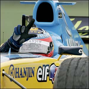 Fernando Alonso celebrates winning the San Marino Grand Prix