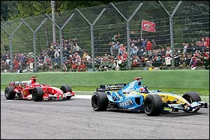 Fernando Alonso holds off the Michael Schumacher to win the San Marino Grand Prix