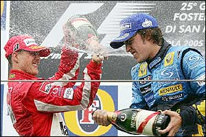 Schumacher and Alonso douse each other in champagne