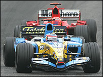 Fernando Alonso holds off Michael Schumacher in the closing stages of the San Marino Grand Prix