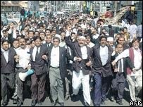 Bangladeshi lawyers shout anti-terrorist slogans during a march in Dhaka following the bomb attacks