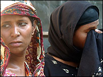 Relatives of people injured in a bomb blast weep outside a hospital in Gazipur