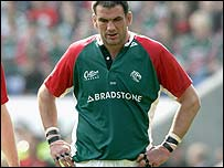 A dejected Martin Johnson leaves the field after Sunday's defeat