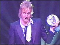 Rhys Ifans picks up his Bafta Cymru award