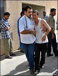 Doctor comforts man injured in Tikrit bombing
