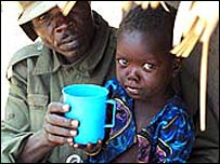 Ugandan soldier and child
