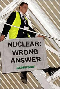 An anti-nuclear protester scales the roof at the Business Design Centre in London