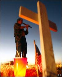 War protester Bob Oehmen plays a Native American flute