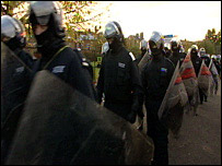 Riot police move in to the squat