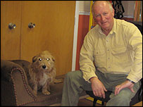 A dog and Dr Roger Mugford