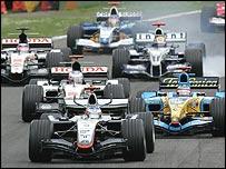 Kimi Raikkonen beats Fernando Alonso and Jenson Button into the first corner of the San Marino Grand Prix