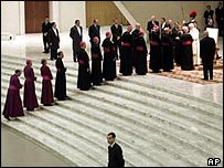 Bishops queue to shake hands with Pope Benedict XVI during his audience with German pilgrims