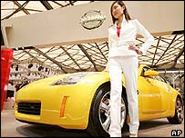 Model standing with a Nissan car at the Auto Shanghai 2005 exhibition
