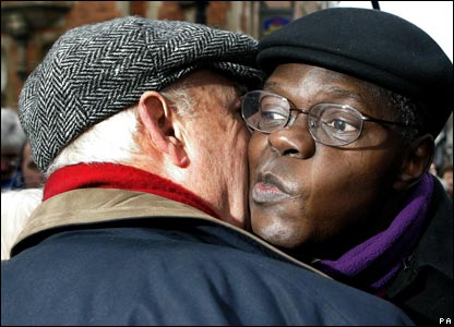 Dr John Sentamu, the new Archbishop of York receives a kiss from a well-wisher in the crowd outside York Minster