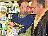 An Italian inspector and unidentified man check out a carton of milk