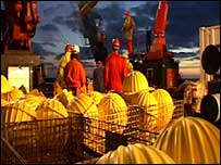 Ship's crew prepare for a night-time deployment of equipment (Image: Nerc)