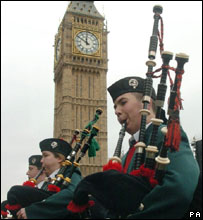 Pipers playing at protest