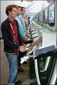 Men playing Xbox 360 console