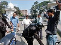 Bangladeshi police search people at the entrance to the High Court in Dhaka