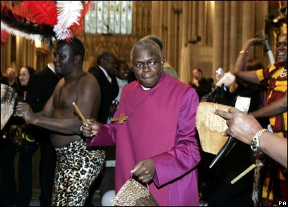 The new archbishop dances with an African band