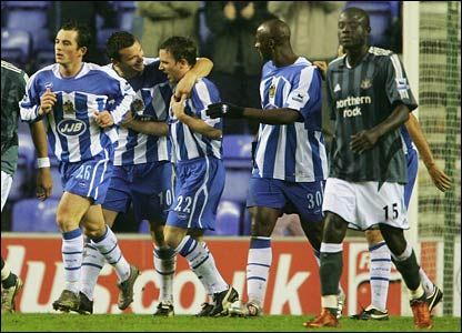 Wigan's players celebrate David Connolly's goal