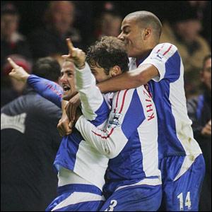 David Thompson (L) celebrates Blackburn's winner