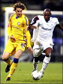 Leicester's Gareth Williams and Bolton's Martin Djetou