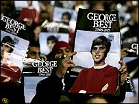 Man Utd fans hold up posters of the legendary George Best