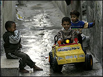 Children play in the al-Shati Refugee camp in Gaza city