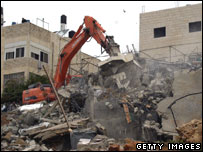 A digger destroys two Palestinian homes in the neighbourhood of Anata northeast Jerusalem