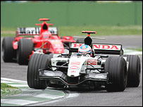 Jenson Button holds off Michael Schumacher during the San Marino Grand Prix
