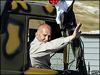Syrian soldier waves goodbye as his convoy leaves Lebanon