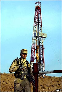 Kurdish fighter guards a DNO drilling site