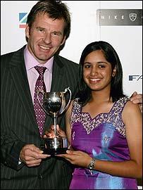 Kiran receives her Faldo Series award from Nick Faldo