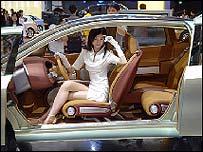 Model posing in luxury car