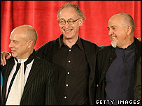 Brian Eno, stage designer Mark Fisher and Peter Gabriel (far right)