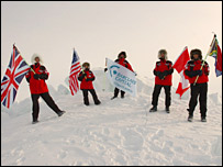 The team display flags at the North Pole