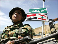 A Syrian soldier walks past the Masnaa border point with Lebanon