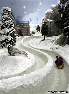 A man slides down the toboggan run