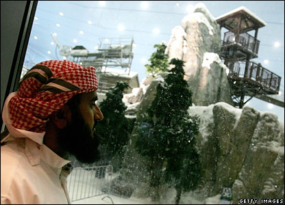 A local in a traditional Emirati Dish-Dash looks at the snowdome