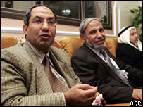 Fadel Zahhar (L) sits next to his brother, Hamas leader Mahmud Zahhar (R)