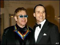 Elton John and partner