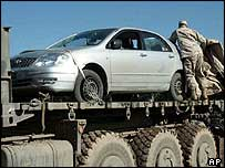 US troops in Iraq load up car believed to be the one fired upon