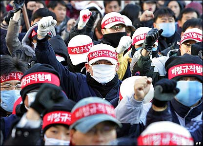 Striking workers shout slogans during an anti-government rally in Seoul